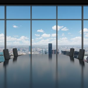 empty boardroom that would usually be filled with people with different leadership and management styles