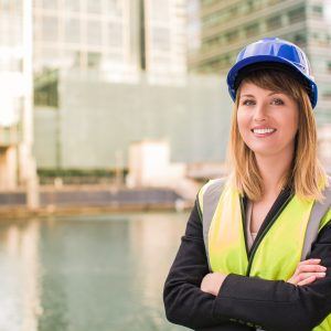 Image of female site manager, including hard hat and highly visible vest. Represents those who will take the site management certificate.